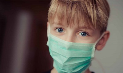 boy wearing surgical mask 695954