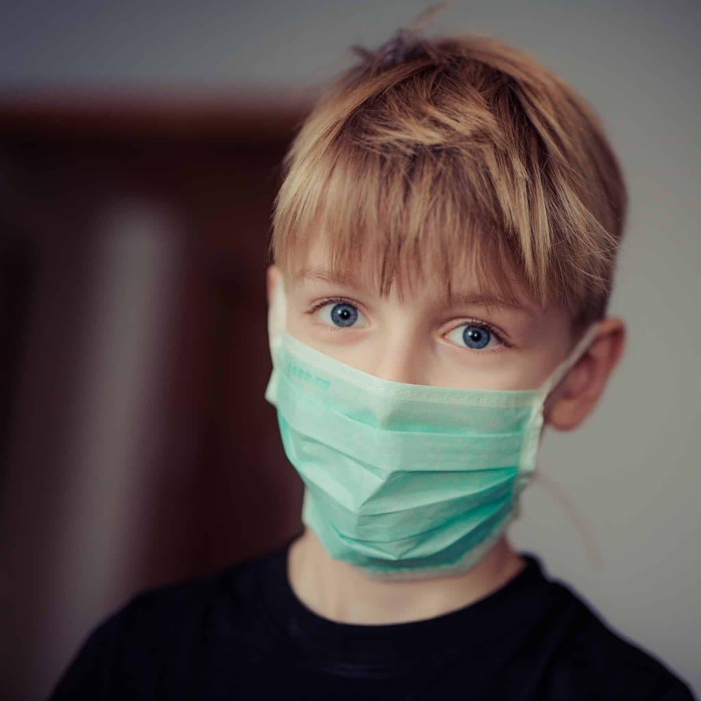 boy wearing surgical mask 695954