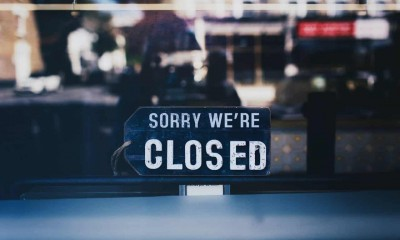 close up photo of sorry we re closed sign on glass window 2467649