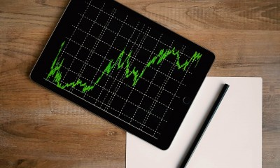 space grey ipad air with graph on brown wooden table 187041 scaled