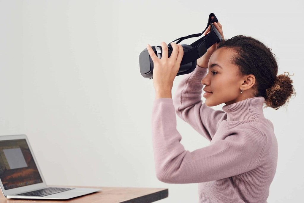 woman holding black vr headset 3183176 scaled