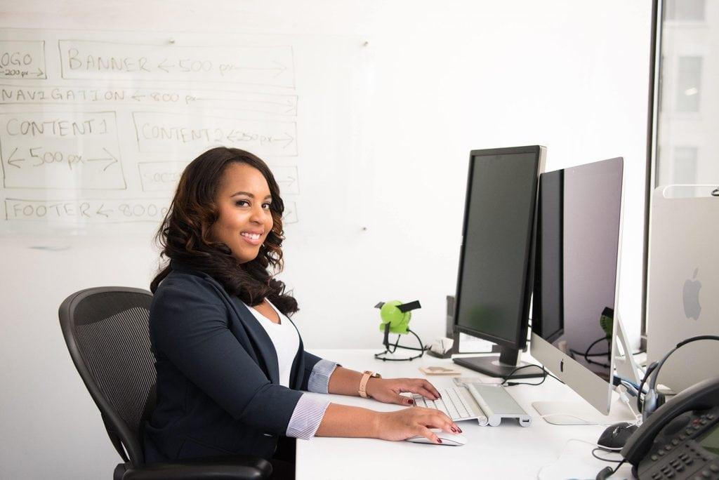 woman wearing black cardigan sitting on black mesh back 1181524 scaled