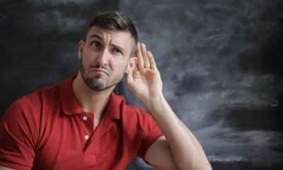 man in red polo shirt sitting near chalkboard 3779448