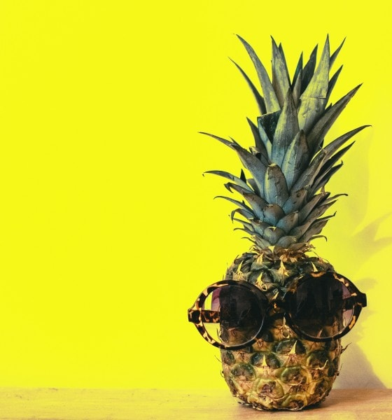green pineapple fruit with brown framed sunglasses beside 1161547
