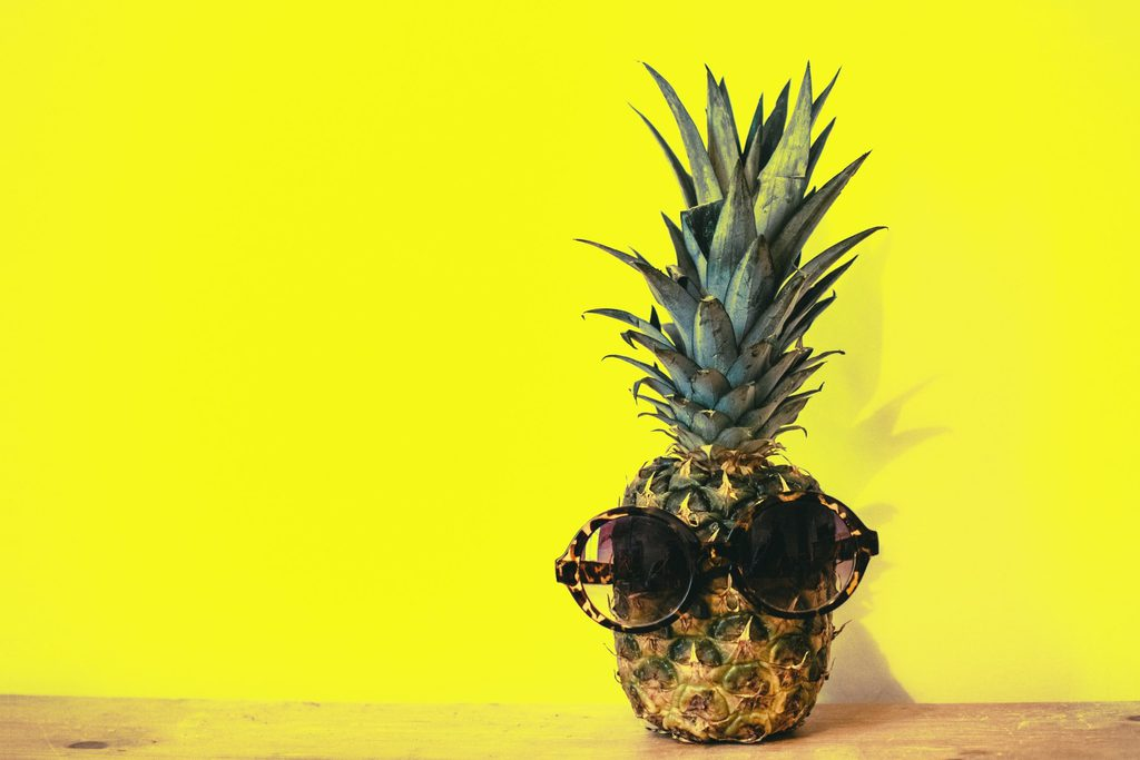 green pineapple fruit with brown framed sunglasses beside 1161547 scaled