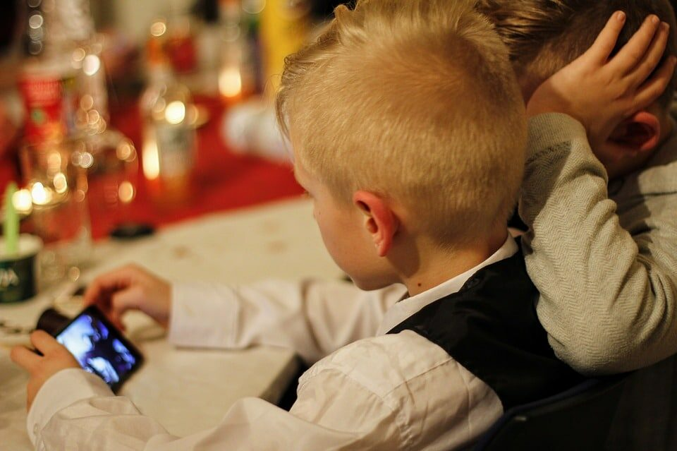 A kid, father and smartphone